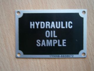 Hinweisschild HYDRAULIC OIL SAMPLE